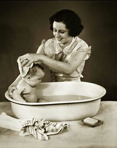 Woman and baby in tub image